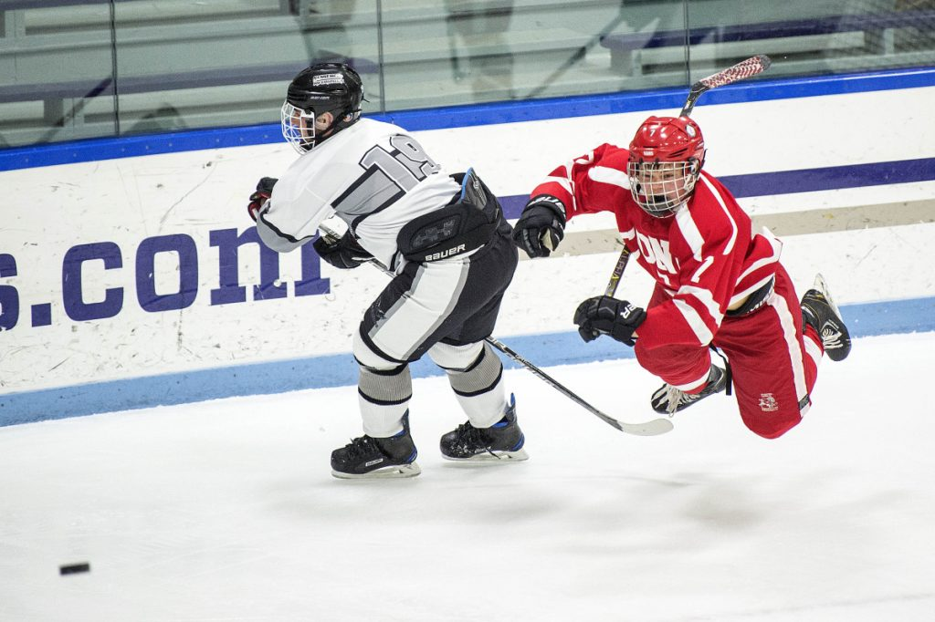 Cony's Elijah Bezanson, right, trips over Kennebec's John Evans on Wednesday at Colby College in Waterville.
