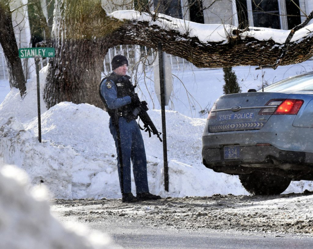 A Maine State Police trooper with an assault rifle stands guard at one end of Stanley Drive in Norridgewock as police search in January 2018 for a suspect in an armed robbery at the nearby Skowhegan Savings Bank.