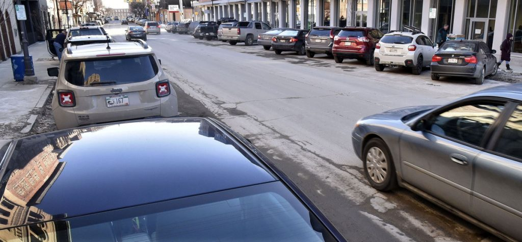 Parking on both sides of Main Street in Waterville, as seen here Thursday, will be reduced if the street is changed to two-way traffic and other infrastructure improvements made with about 65 spots being lost.