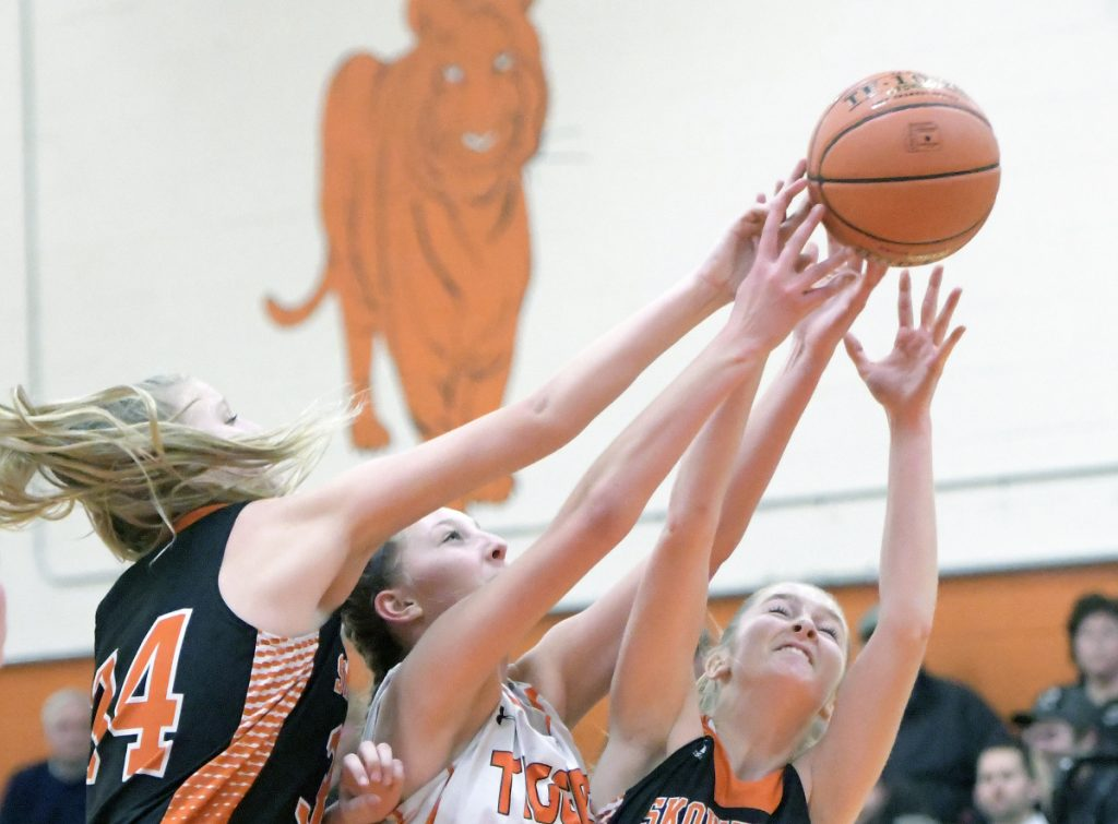 Gardiner's Bailey Poore, center, attempts to grab a rebound from Skowhegan's Sydney Reed, right, and Mariah Dunbar during a game Thursday in Gardiner.