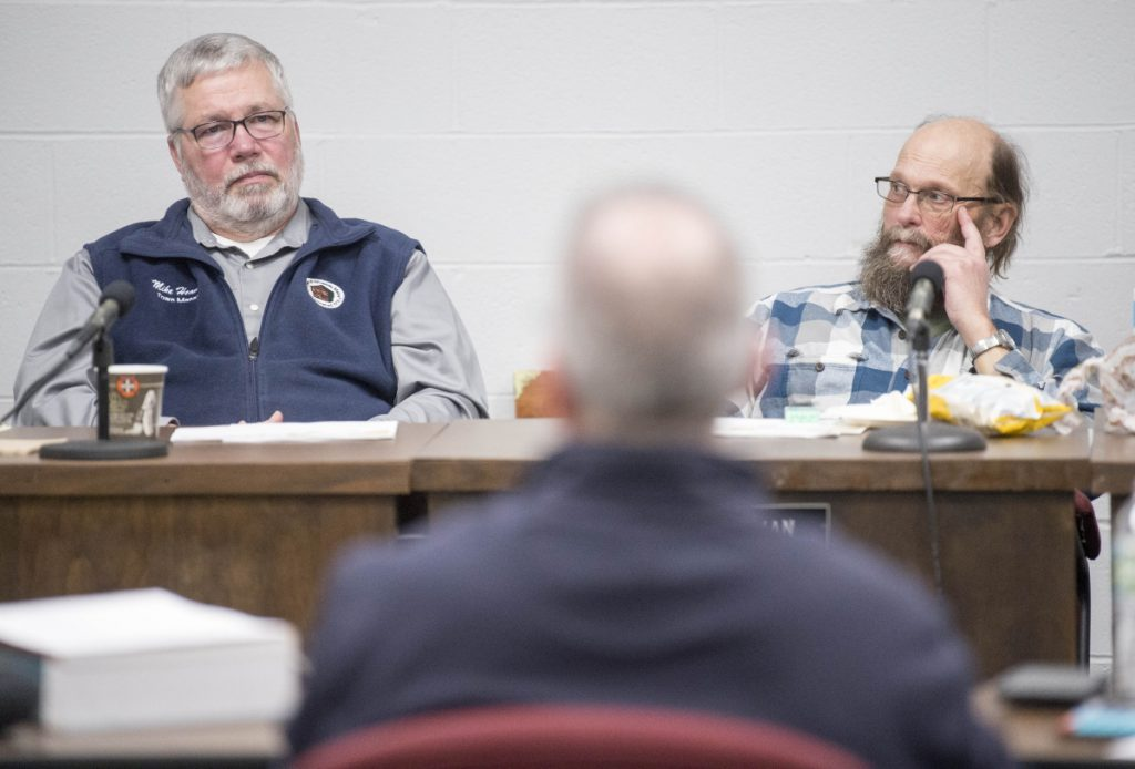 Winslow Fire Chief Ronnie Rodriguez, back center, discusses adding more full-time firefighters with Town Manager Mike Heavener, left, and Town Council Chairman Steve Russell, right, on Friday at the Winslow Town Office.