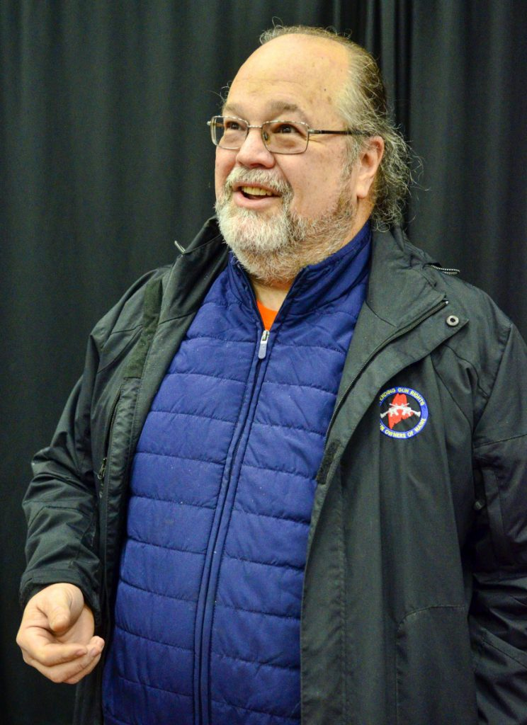 Todd Tolhurst, president of the Gun Owners of Maine, answers questions during a gun show Saturday at the Augusta Civic Center.