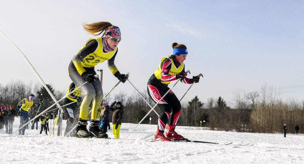 Maranacook's Maura Taylor, left, and Central Maine Academy's Emma Digiralomo race during the Maranacook Waves on Saturday at Quarry Road Trails in Waterville.