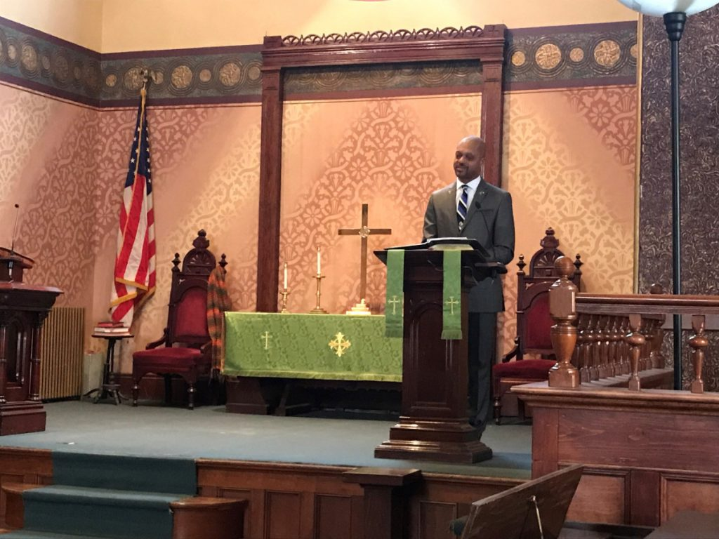Rep. Craig Hickman, D-Winthrop, speaks to a group gathered at the Old South First Congregational Church Monday in honor of Dr. Martin Luther King Jr., who would have turned 90 years old Jan. 15.