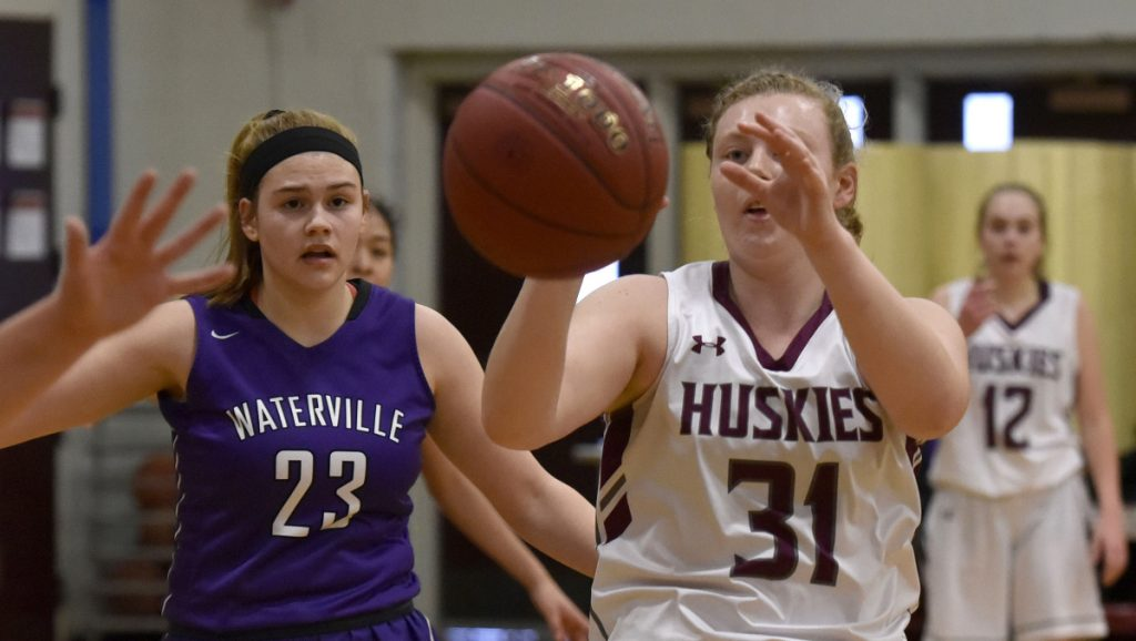 MCI senior Christa Carr takes a pass as Waterville defender Madeleine Martin closes in during a Kennebec Valley Athletic Conference Class B game Monday afternoon in Pittsfield.