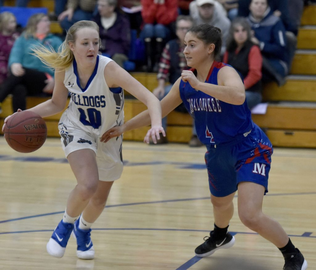 Lawrence's Keagan Alley looks to fend off Messalonskee defender Sarah Lowell during a Kennebec Valley Athletic Conference Class A North game Monday night in Fairfield.