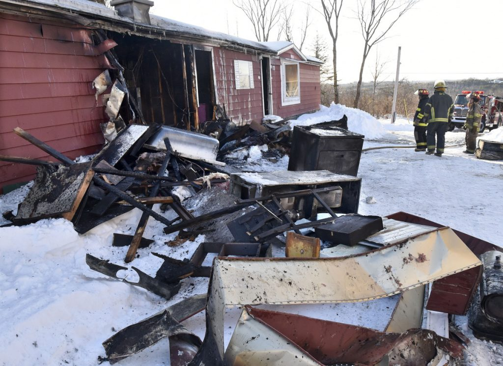Household items were pulled from the remains of a mobile home Tuesday at 773 East Ridge Road in Cornville that was destroyed by fire. Firefighters from Cornville, Madison and Skowhegan arrived to put the fire out.