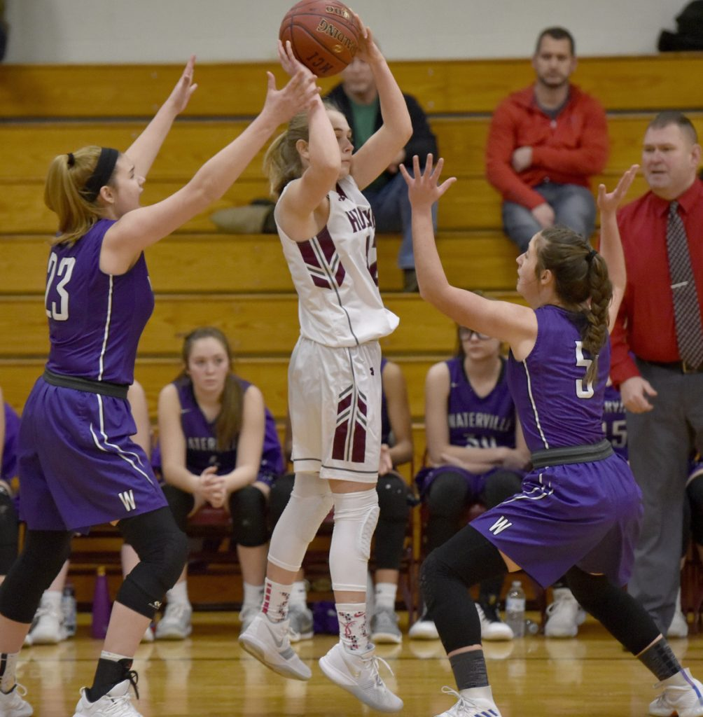 MCI's Sara Linkletter looks to make a pass as Waterville defenders Madeleine Martin, left, and Jayda Murray apply pressure during a Kennebec Valley Athletic Conference Class B game Monday afternoon in Pittsfield.