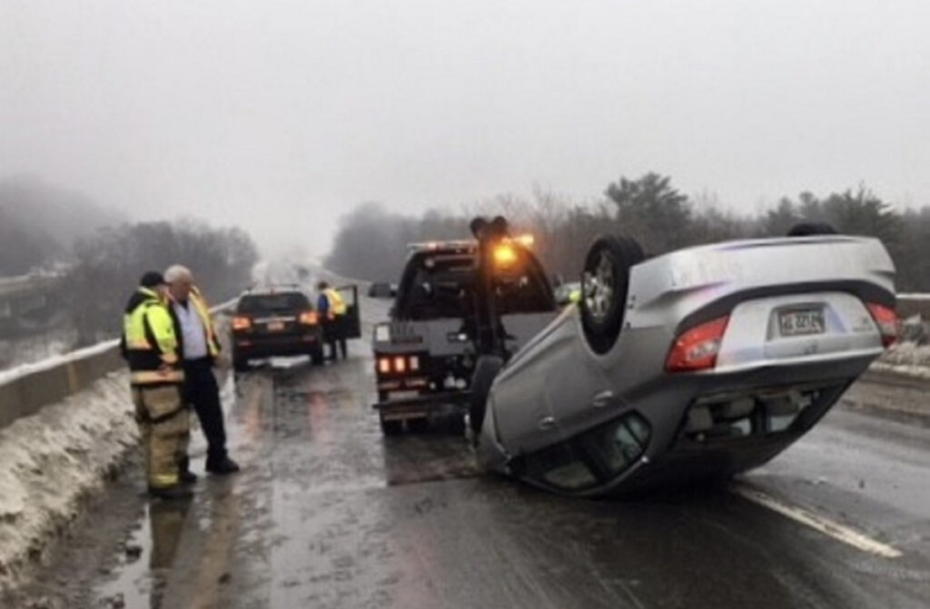 A Newport woman lost control of her Honda Civic on Thursday morning as she was traveling north on Interstate 95. The car struck abutments of the Messalonskee Stream bridge and fliped onto its roof. Rain had started to freeze on the bridge, according to Steve McCausland, the spokesman for the state Department of Public Safety.