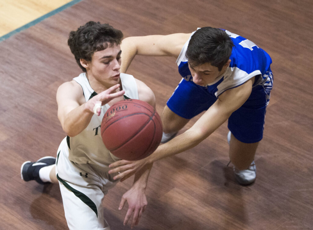 Temple Academy's Noah Shepherd (14) left, tries to dribble past Valley  defender Zachary Walter (11) on Thursday in Waterville.