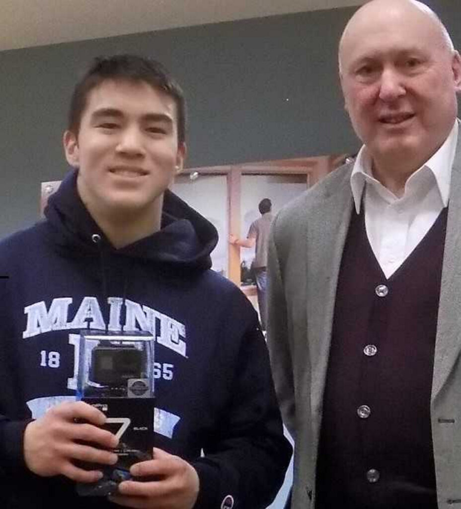 "Ely Yang, left, a student at Winslow High School, and Allen Rancourt, president of Kennebec Federal Savings. Yang was selected by Kennebec Federal Savings as the winner of the preliminary round of the ""Lights, Camera, Save!"" video competition ssponsored by the American Bankers Association. He was presented a new GoPro camera at a ceremony Jan. 4 in Waterville."