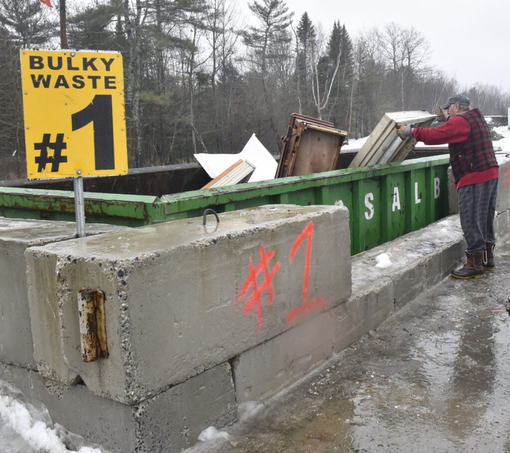 Vassalboro resident Ray Manocchio puts debris into a bulk waste dumpster Thursday at the Vassalboro Transfer Station. Vassalboro selectmen voted to end single-sort recycling at their Thursday meeting. All of the town's waste, including the recycling, goes to the Norridgewock landfill until the Fiberight plant in Hampden opens.