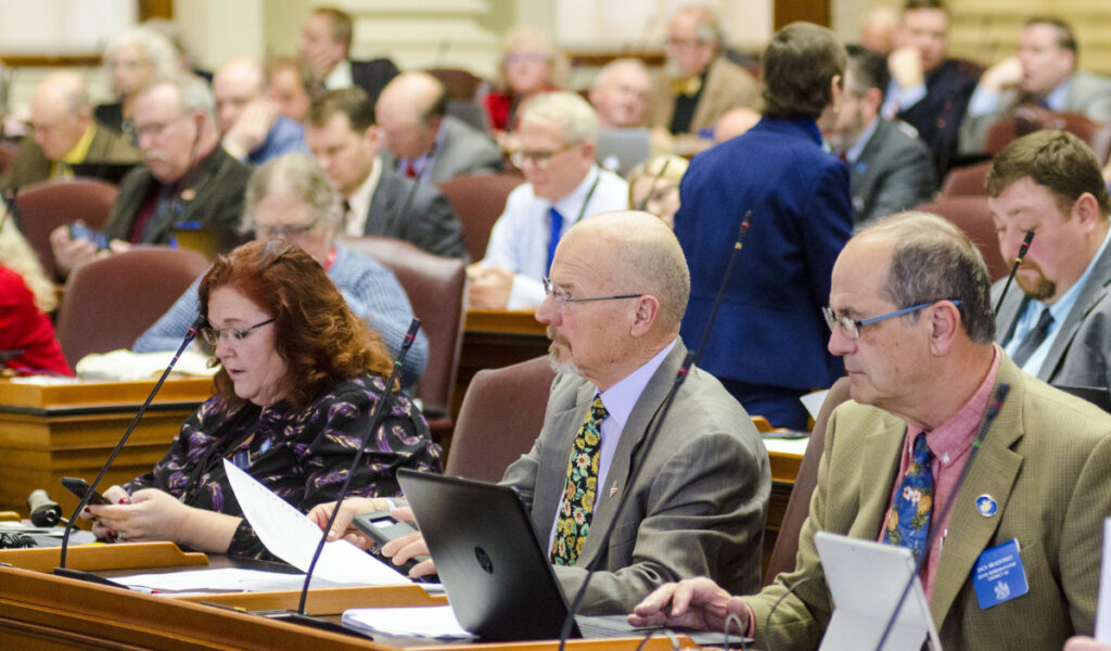 From left, Rep. Shelley Rudnicki, R-Fairfield, Rep. Larry Lockman, R-Bradley, and Rep. Dick Bradstreet, R-Vassalboro, sit in the front row of the Maine House of Representative during a session on Thursday at the State House in Augusta.