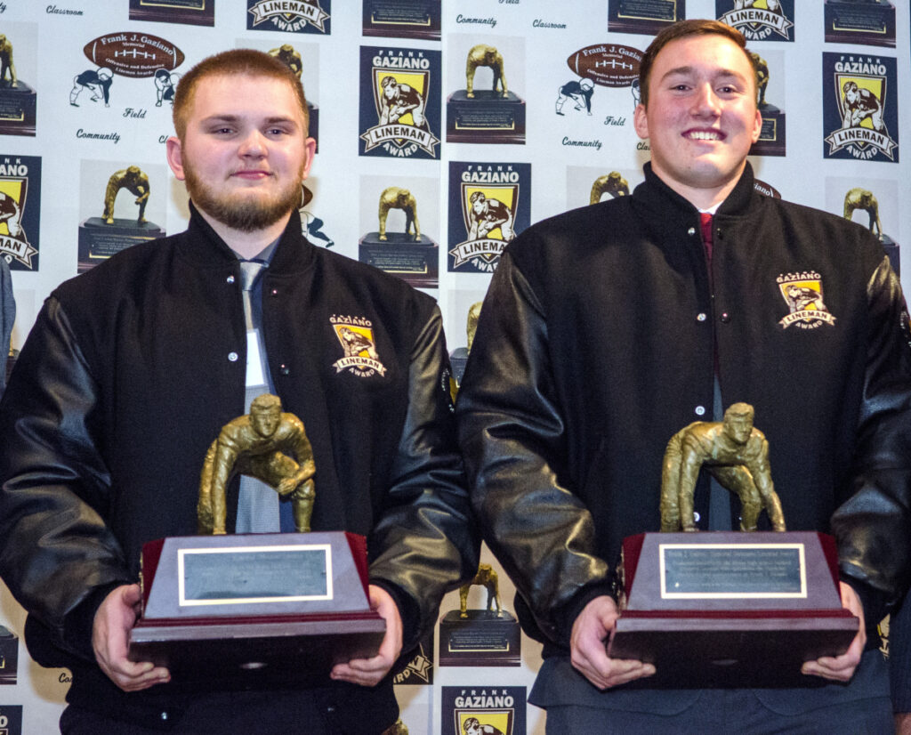 Offensive lineman Aidan McGlone, left, and defensive lineman Thomas Palmer hold trophies they won at the Frank Gaziano Award ceremony Saturday at the Augusta Civic Center.