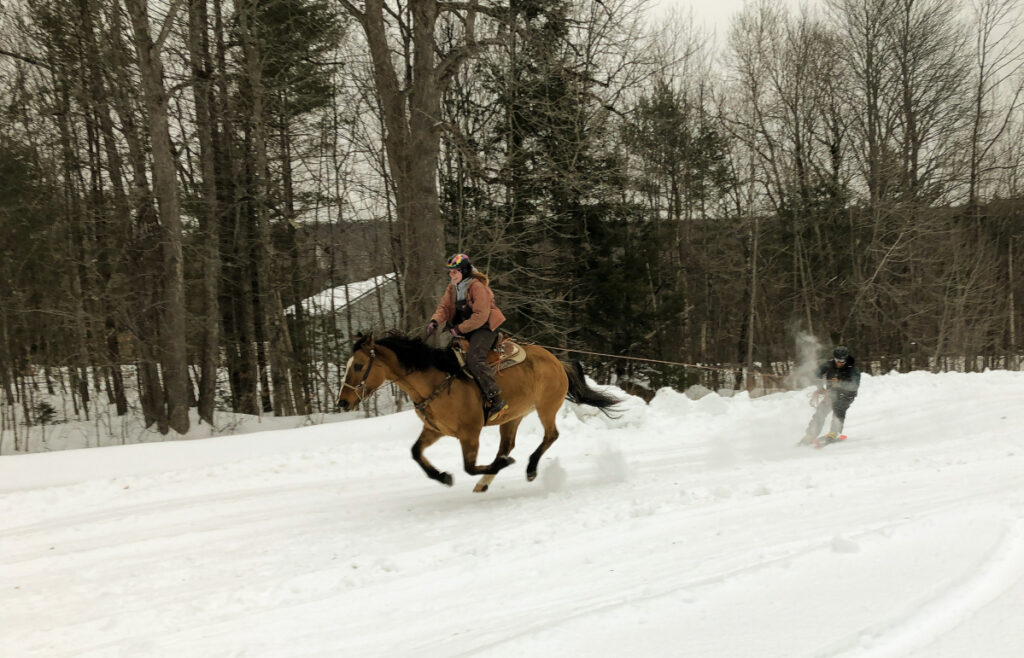Meg Foster gallops her mount, towing skier Luke Disilvestro, during a recent skijor practice event leading up to the Feb. 8-10 Somerset SnowFest in Skowhegan, Canaan and Madison.