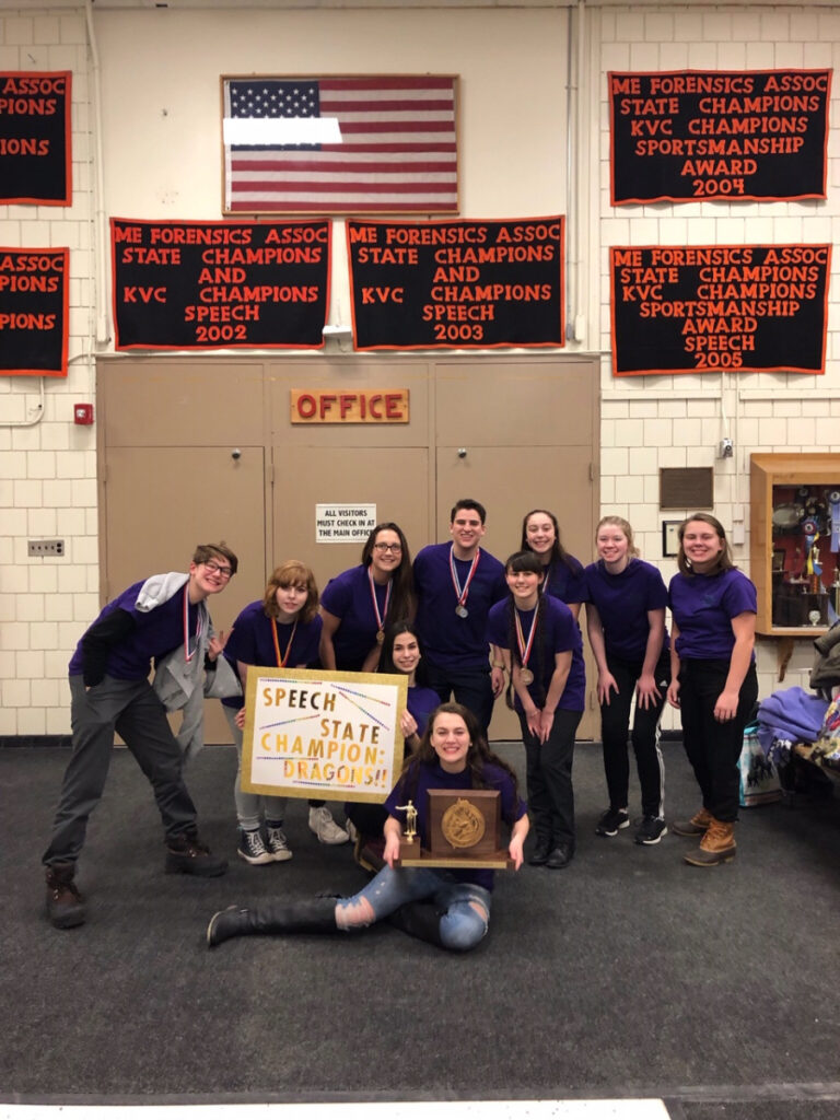 The Skowhegan Area High School speech team, pictured from left to right, are, in front, Emma York, holding their trophy; in the middle row, Sophie Wheeler, holding a sign, and Maggie Pono; and in the back, Anna Bourassa, Romy Gerstenberger, Victoria Broadley, Taylor Kruse, Lizzy Steeves, Emily Lyman and Amber Merry.