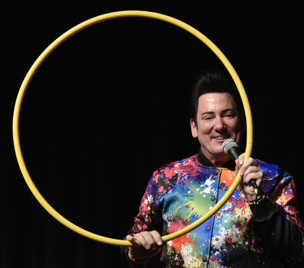 Motivational speaker Retro Bill's presentation Tuesday to Lawrence High School students at the Williamson Center in Fairfield used many colorful props, including a hula hoop, to illustrate that good deeds are cyclical and come back to you.