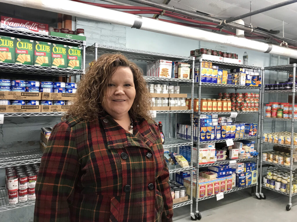 Board Chairwoman Shannon Drury, shown Tuesday evening at the People Who Care Food Cupboard in Madison, has taken criticism recently for some of the changes that have occurred in the organization.