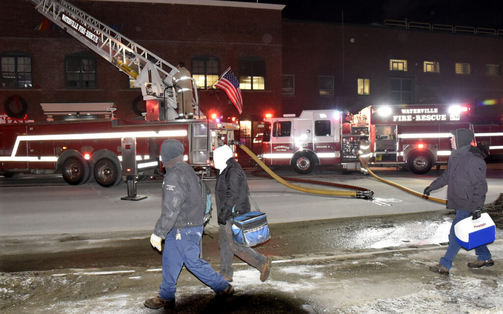 Employees at the Huhtamaki mill in Waterville and Fairfield were evacuated as fire departments from several towns responded to a fire and concentrated on the roof on Tuesday evening. Hot spots flared up Wednesday, prompting area fire departments to revisit the site of Tuesday's fire.
