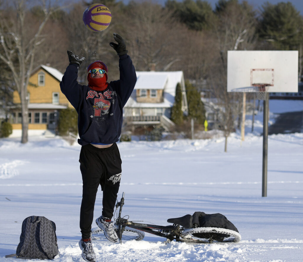 James Wiggins, of Augusta, shoots free throws Wednesday on a fresh coat of snow at Williams Playground in Augusta. Wiggins said he likes to play basketball in every kind of weather and rides his bicycle all year.