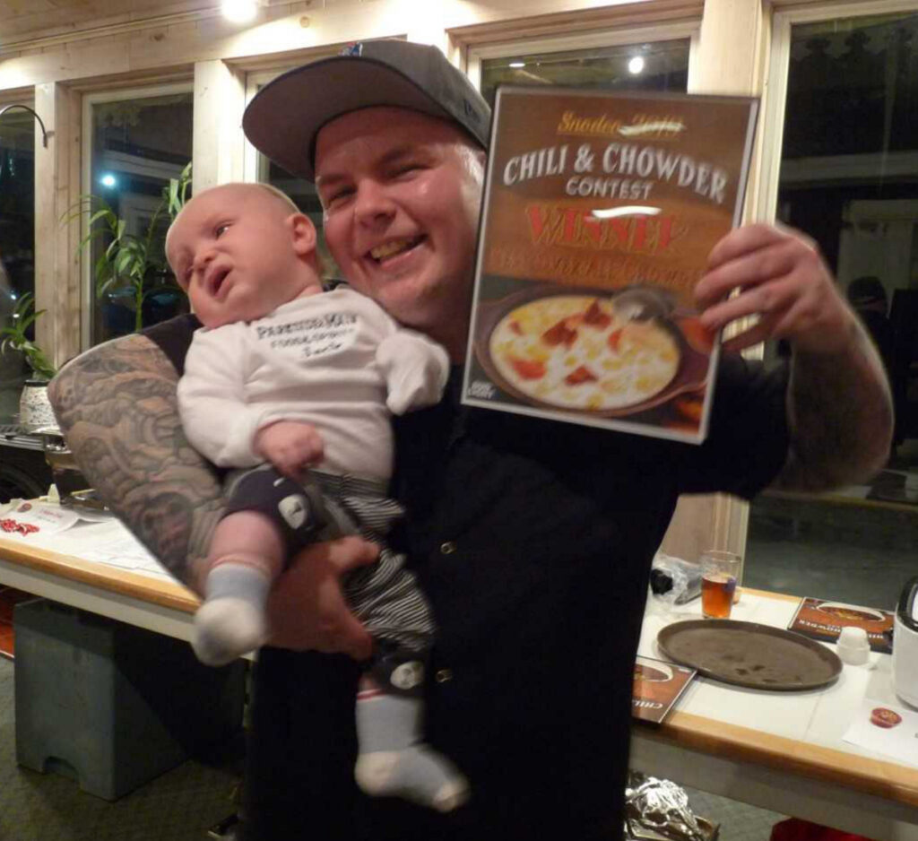 """Jarrod Beedy, with """"assistant"""" Jack, representing Parkside & Main, winner of Best Overall Chowder contest hosted by the Rangeley Lakes Chamber of Commerce."""