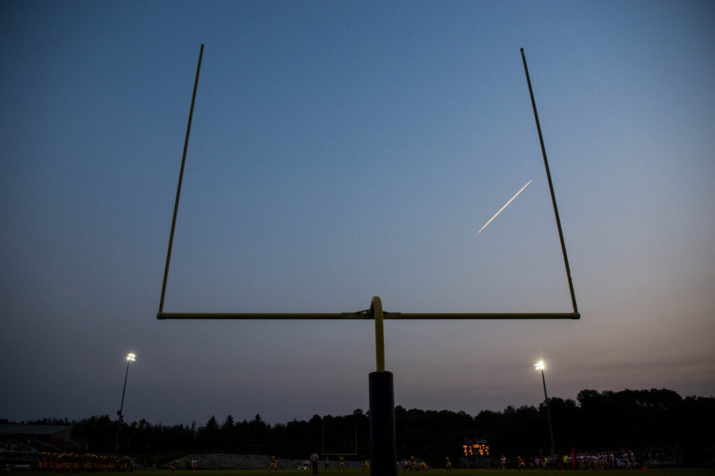 A jet's vapor trail is seen last September above Caldwell Field on the Mt. Blue High School campus in Farmington during a preseason football game against Augusta's Cony High School.