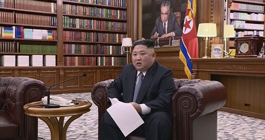 North Korean leader Kim Jong Un delivers a speech in this undated photo distributed Jan. 1.