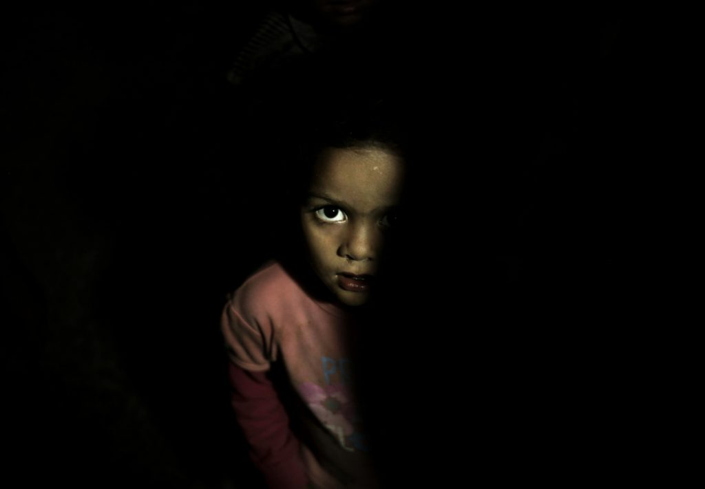 A child stands in a room at a shelter for displaced people in Ibb, Yemen, in August.