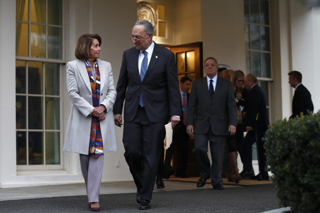 House Democratic leader Nancy Pelosi of California, left, walks with Senate Minority Leader Chuck Schumer, D-N.Y., as Democratic leaders including Sen. Dick Durbin, D-Ill., at right, arrive to speak to the media after meeting with President Trump on border security on Wednesday at the White House in Washington. (AP Photo/)