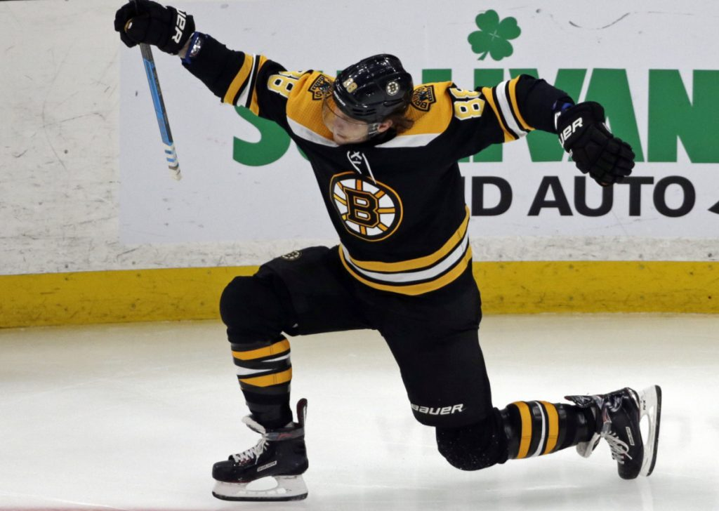 Boston Bruins right wing David Pastrnak (88) celebrates his goal in the third period of an NHL hockey game against the Calgary Flames, Thursday, Jan. 3, 2019, in Boston. (AP Photo/Elise Amendola)
