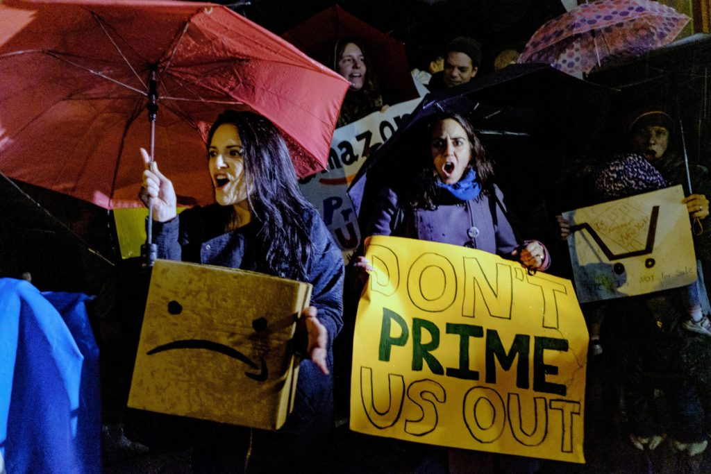 Demonstrators protest against the planned Amazon.com office hub in Long Island City, located in the New York city borough of Queens, on Nov. 26, 2018. MUST CREDIT: Bloomberg photo by Christopher Lee.