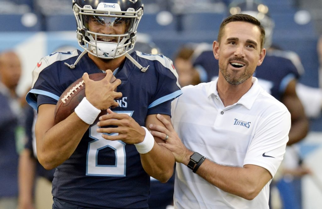 Tennessee quarterback Marcus Mariota talks with offensive coordinator Matt LaFleur before a preseason NFL football game against the Minnesota Vikings in Nashville, Tenn. A person familiar with the decision says LaFleur has accepted Green Bay's offer to become the next head coach of the Packers.