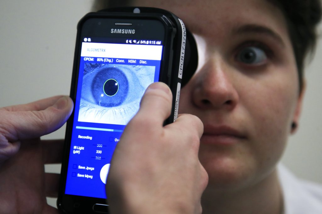 Clinical Research Assistant Kevin Jackson uses AlgometRx Platform Technology on Sarah Taylor's eyes to measure her degree of pain at the Children's National Medical Center in Washington.