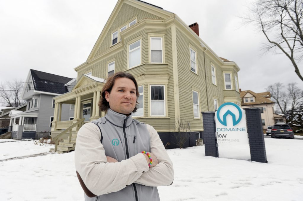 """Chris Lavoie, a real estate broker with Keller Williams/Domaine office, says the government shutdown has delayed action on a federally backed loan that he planned to use to buy a commercial property in Portland. """"That's costing me money,"""" Lavoie said."""