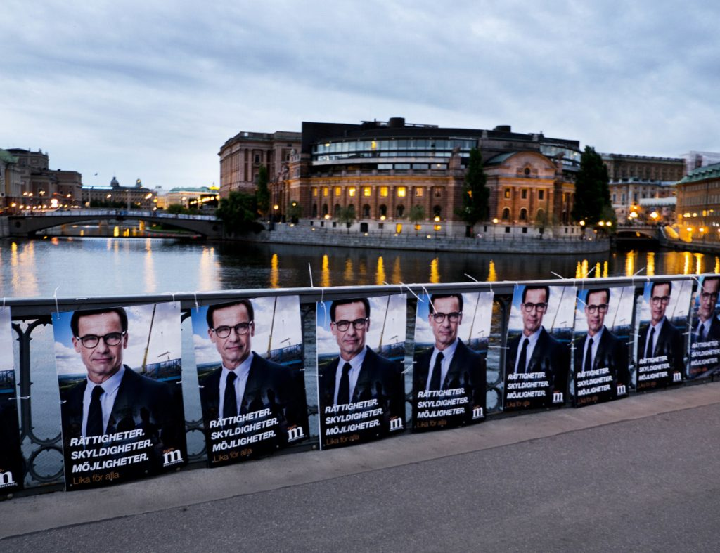 Election posters of the Moderate Party's Ulf Kristersson line a bridge in front of the Swedish parliament in Stockholm, Sweden, last year. High taxes are generally accepted in Sweden and other Nordic countries, where state benefits are more generous than in the United States.