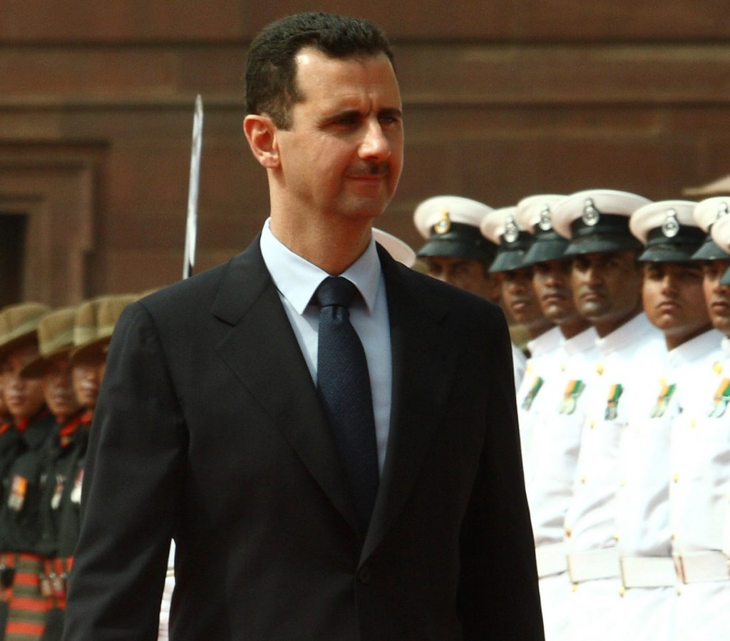 Bashar Assad, president of Syria, inspects an honor guard at a welcoming ceremony during a 2008 visit to India. Russia's intervention reversed the war.