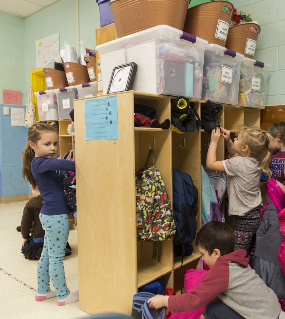 Pre-kindergarten students store their snow clothes in their cubbies after returning to class at John F. Kennedy Memorial School in Biddeford, which has one of the few districts in Maine that offer pre-K to all 4-year-olds who want to attend.