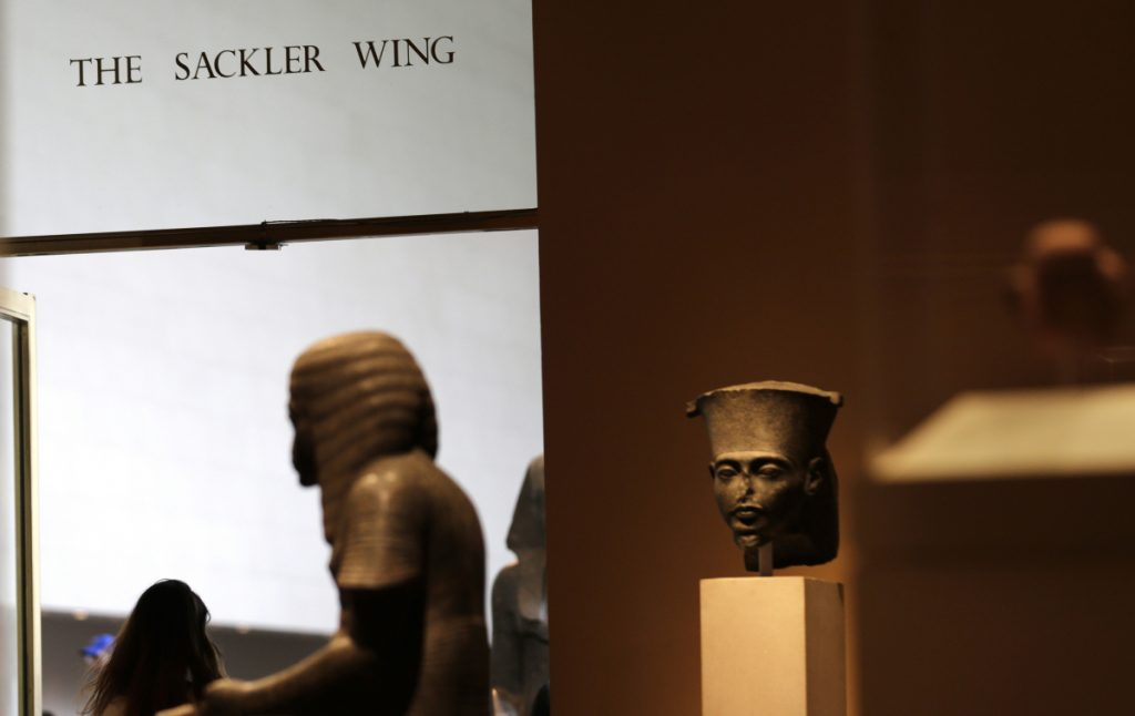 A sign with the Sackler name is displayed at the Metropolitan Museum of Art in New York. The Sackler name adorns walls at some of the world's top museums and universities.