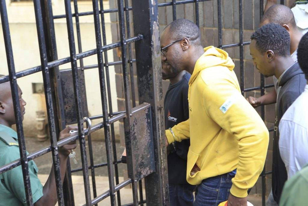 Pastor and activist Evan Mawarire, arrives handcuffed at the magistrates courts in Harare, Zimbabwe on Friday.