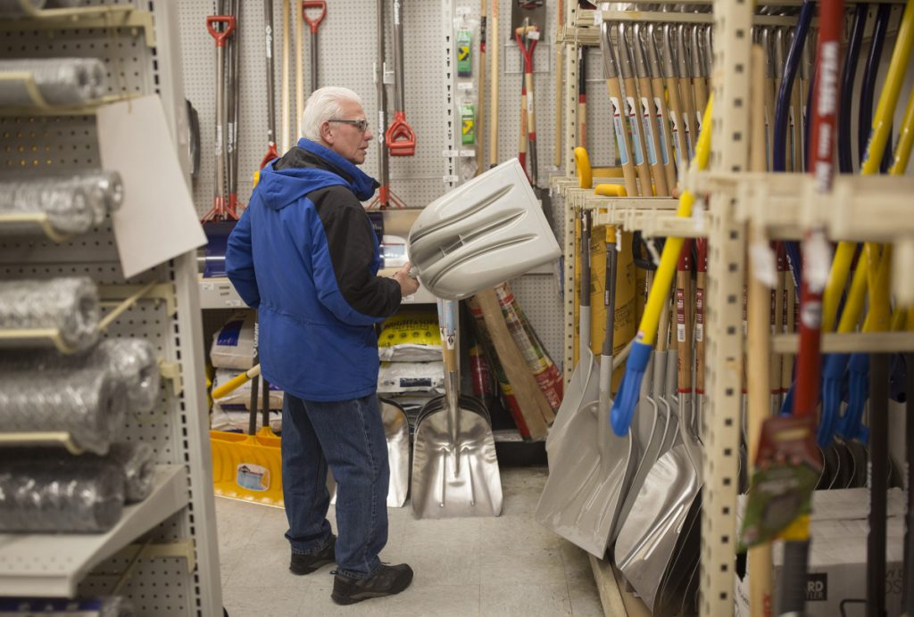 Bruce Little of Portland looks through Maine Hardware's selection of shovels Friday. The greatest uncertainty with this weekend's storm appears to be along the coast, where snow could turn to sleet at some point to keep snowfall totals down.