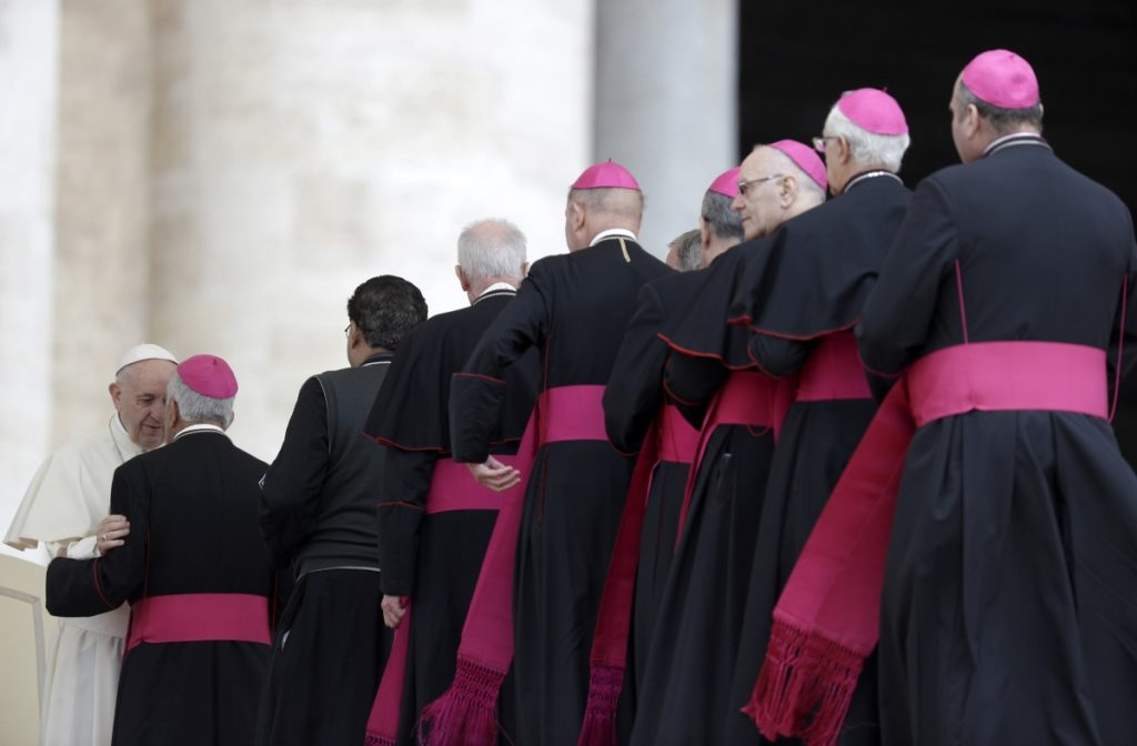 Bishops line up to greet Pope Francis during his weekly audience in St. Peter's Basilica at the Vatican last spring. Catholic doctrine mandates an all-male priesthood, on the grounds that Jesus' apostles were men.