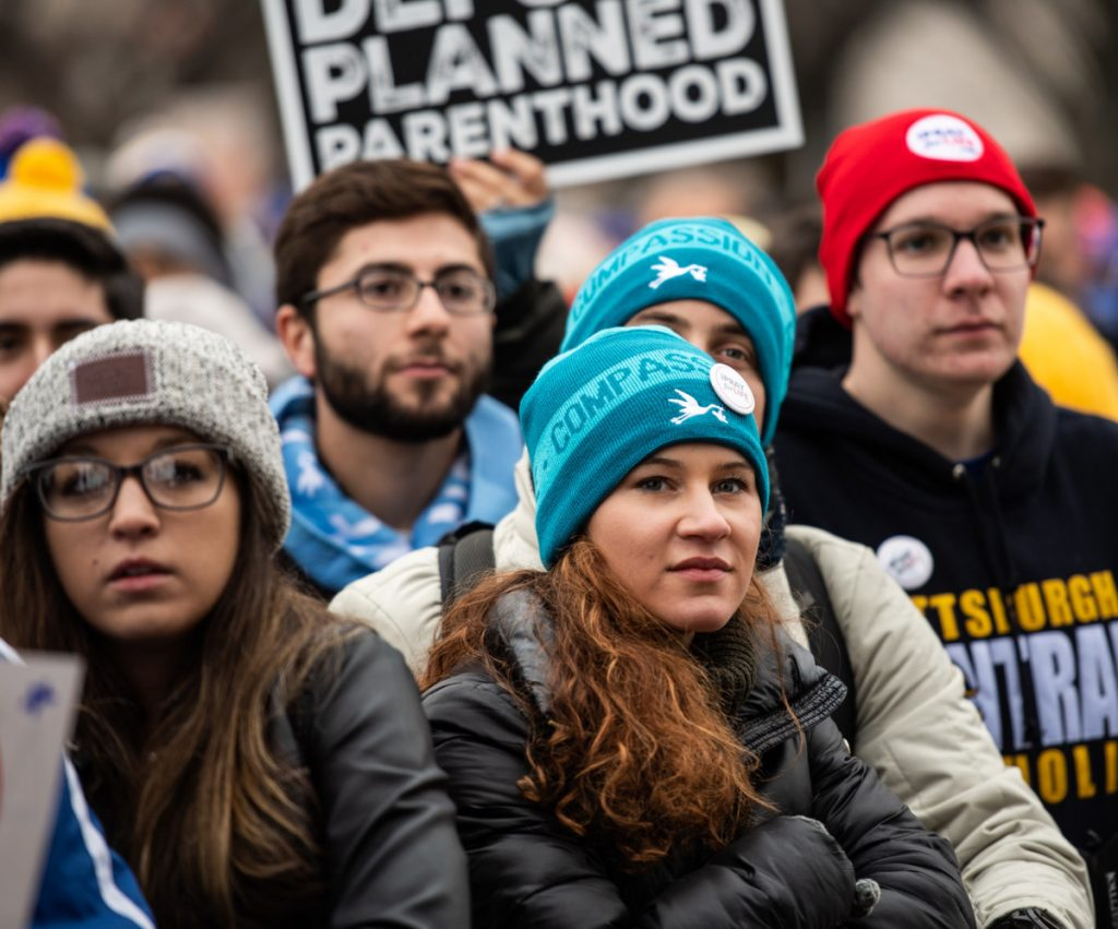 Crowds listen intently at the March for Life rally Friday on the National Mall. President Trump spoke to the participants via video.