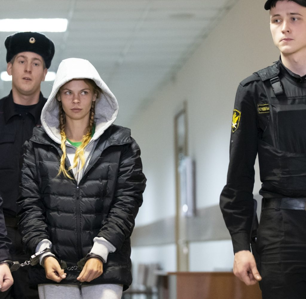 Anastasia Vashukevich, a Belarusian model also known on social media as Nastya Rybka, center, is escorted into the courtroom in Moscow on Saturday. Her detention was extended for three days.