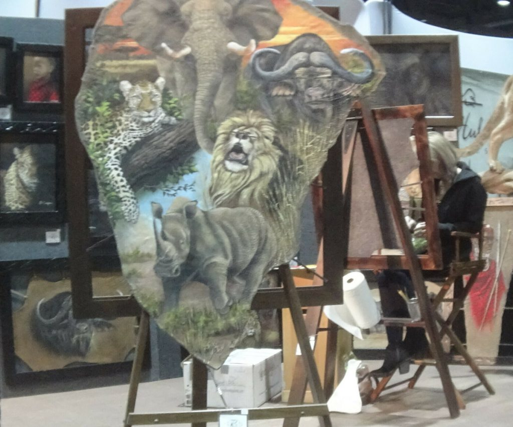 A painting on elephant hide is displayed at the Safari Club International conference in Reno, Nev., on Jan. 9. Federal and state laws restrict the sale of hides from African elephants and an investigation has been opened.