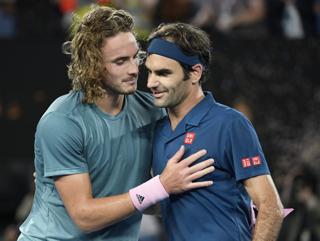 Stefanos Tsitsipas, left, reached the quarterfinals of a Grand Slam for the first time by upsetting defending champion Roger Federer at the Australian Open.