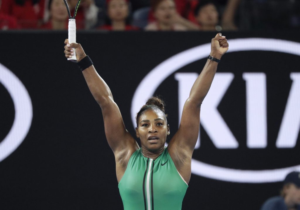 Serena Williams celebrates after defeating Simona Halep in their fourth round match at the Australian Open on Monday in Melbourne, Australia.