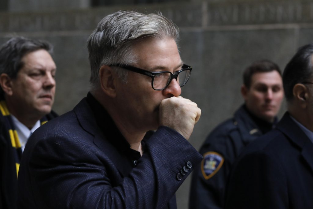 Alec Baldwin leaves court in New York City on Wednesday after a hearing on charges that he slugged a man during a dispute over a parking spot in November.
