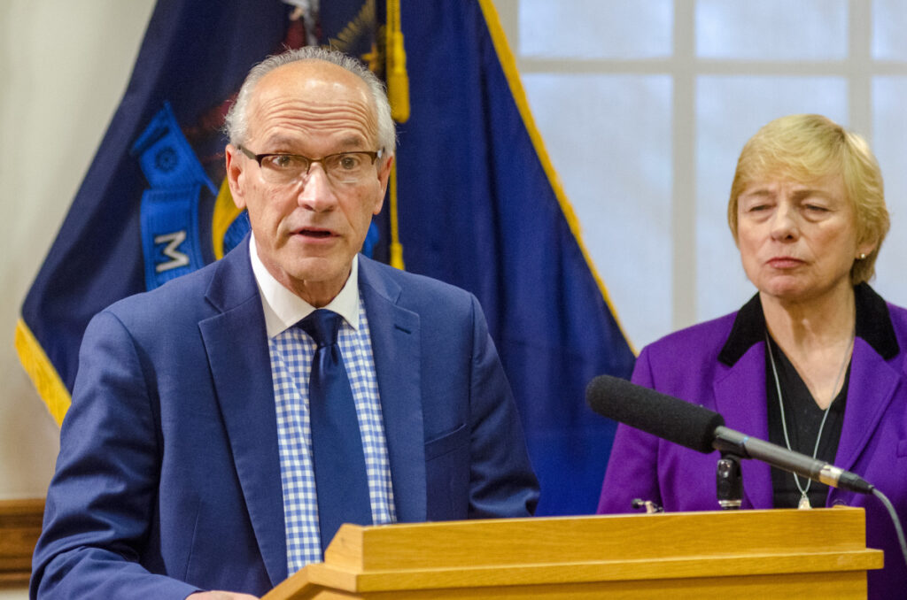 """Gordon Smith, left, is named by Gov. Janet Mills as the state's first-ever director of opioid response at a news conference on Thursday at the State House. He said, """"The opioid epidemic continues to take a horrific toll on our state."""""""