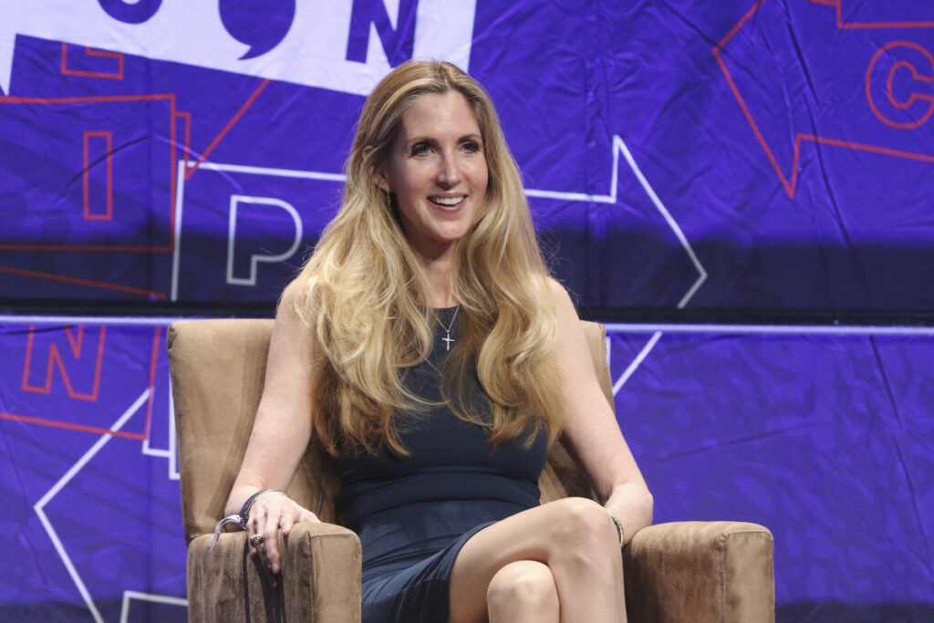"""FILE - In this Oct. 20, 2018 file photo, Ann Coulter participates in the """"AAA: Ask Ann Anything"""" panel at Politicon at the Los Angeles Convention Center in Los Angeles. President Donald Trump defended himself Saturday from a conservative backlash that he himself unleashed when he ended the 35-day-old partial government shutdown without money for his promised border wall.  Coulter, a big supporter of a barrier on the southern border, called Trump the """"biggest wimp"""" ever to occupy the Oval Office. (Photo by Willy Sanjuan/Invision/AP, File)"""