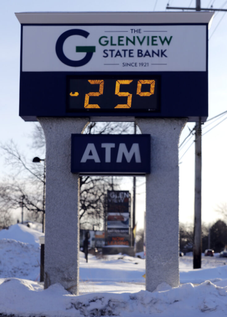 A sign shows the outdoor temperature in Glenview, Ill., Wednesday